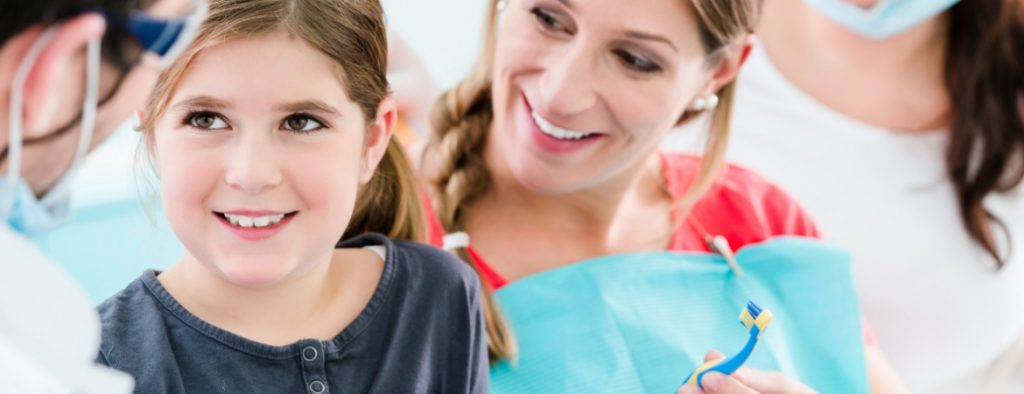 Child patient smiling at family dentist
